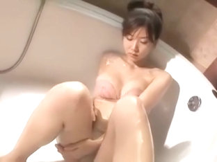Some busty asian in the bath