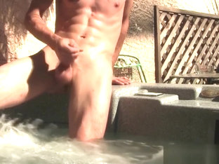 Cheerful Derrick Dickem jerking off poolside solo