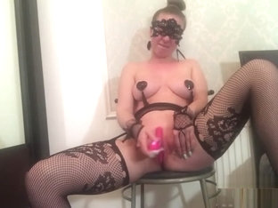 Wearing fishnet stockings and fucking myself with a dildo