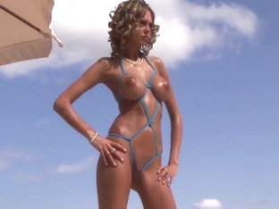Beauty posing in extreme micro bikini 2