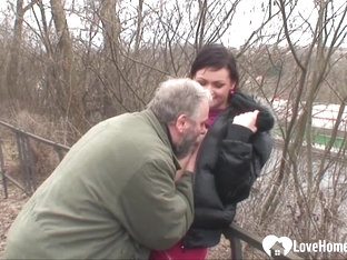 Cute woman and an older dude fuck outdoors