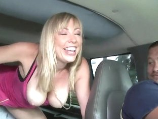 Blonde slut Adrianna Nicole getting a threesome inside a car