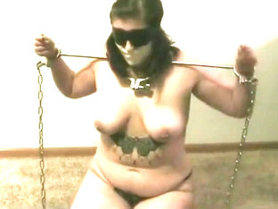 Chained girl tries to escape and then tormented
