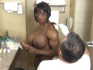 Extremely muscular ebony getting ready