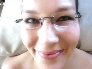 Hottie with glasses takes a facial cumshot