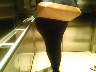 Candid elevator booty