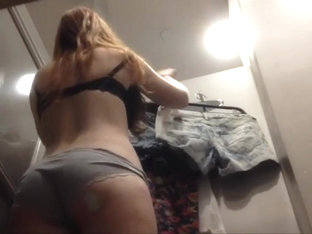 Cute girl tries on short hot pants