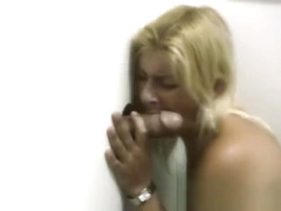 Blonde Amateur On Her Knees Sucking Dick Through Glory Hole