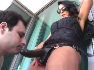 Strapon fuck on balcony