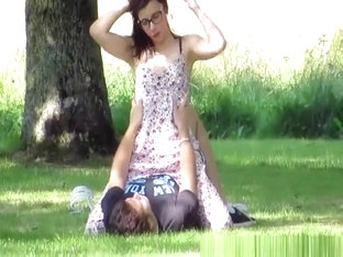 Teen couple making out in the public park