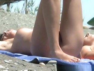Nudist woman with hairy pussy sunbathing
