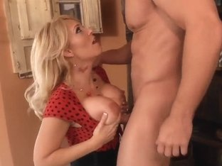 Big tited milf Charlee Chase gives a nice tits fuck to Johnny Castle