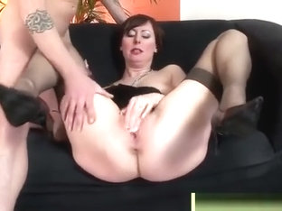 Mother getting banged at her black sofa
