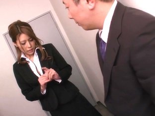 Haruka Sanada, busty Asian office lady gives hot handjob