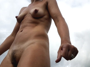 MILF outdoors, super sexy body. Unaware of spycam