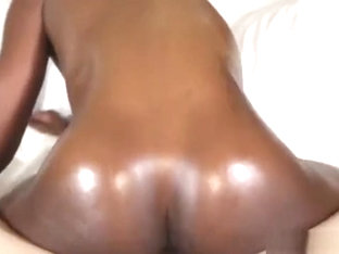 Silky ebony Ana Foxxx bounces her oiled up ass on a white schlong