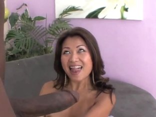 Tanned asian milf Jackie Lin takes on black cannon