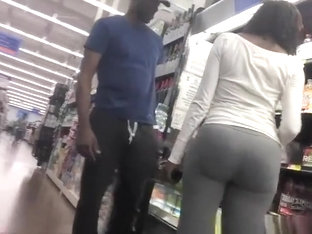 Ebony woman with nice boot in gray leggings