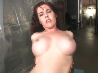 Buxom redhead milf Mae wildly fucks a big black pole in the warehouse