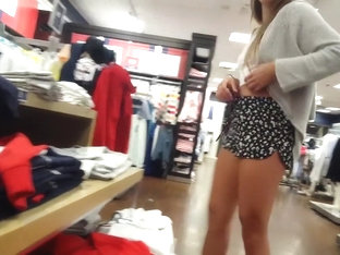 Candid voyeur tall thick blonde bend over in shorts shopping