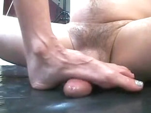 Mature brunette wife gives her man a footjob and plays with cum afterward