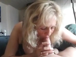 Busty mature blonde gives an amazing blowjob in pov
