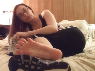 Amber Lilly tasting her sweaty sneakers and foot