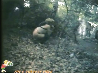 Voyeur catches a hot babe pissing in the woods