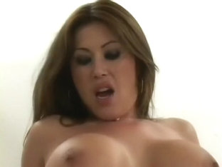 Big breasted Asian babe Kianna Dior has two studs sharing her pussy