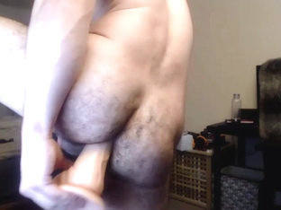 Handsome man shoves a 12-inches dildo up his hairy moist ass cunt.