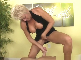 Busty Mature Wanks Cock With Her Fake Tits