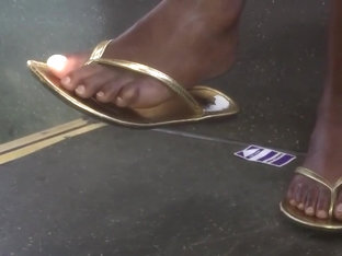 Sexy ebony feet in gold flip flops pt.2