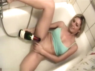 Horny Blonde Masturbating With A Bottle