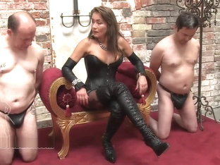 Leather mistress whips her slave before he gets sold