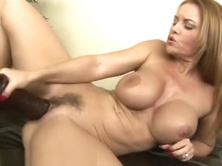 Busty milf Janet taking every foot of a big brutal dildo