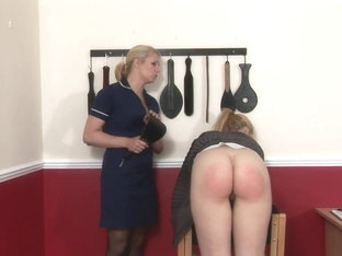 Kinky blonde teacher is spanking one of her naughty girls, to teach her a lesson