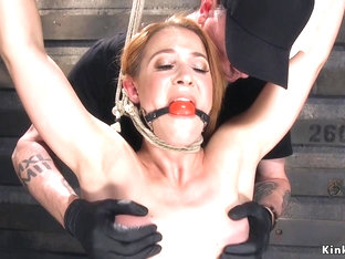 Hogtied redhead babe caned and whipped