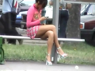 Sneaky peep of a bored girl on a bus stop