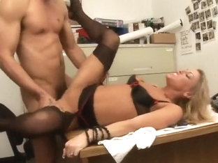 Nasty blonde secretary feeds her passion for black cock in the office